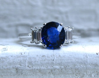 14K White Gold Diamond and Sapphire Ring Engagement Ring with Baguette Cut Diamonds.