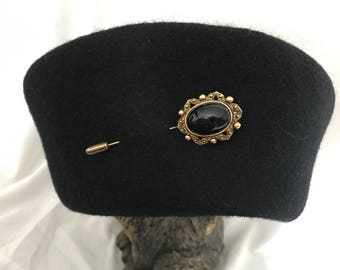 Pill box hat