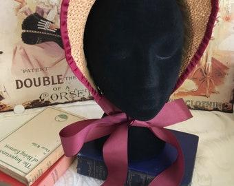 Regency style lightweight straw bonnet with plum/ burgundy coloured trim.