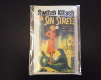 Switch kitsch: Sin street switch plate. Sealed.