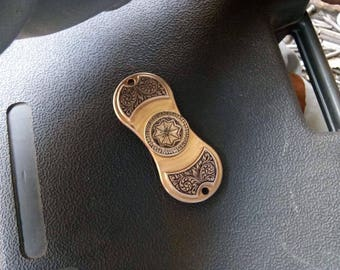 Brass spinners with hand engraving