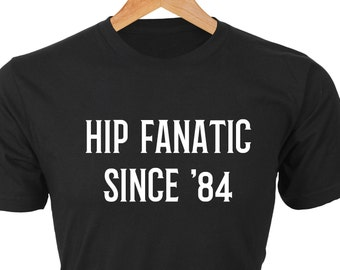 Hip Fanatic Since '84 — Classic black T with white words created for fans of The Tragically Hip since founded in 1984