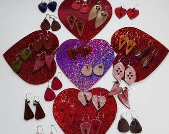 2@ 25.00 Hand Cut Leather Earrings