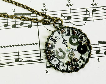 Watch necklace effect resin inlaid with small craft items, rhinestones and pearls