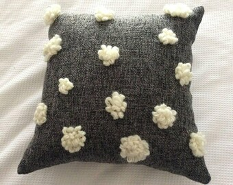 Charcoal and white fluffy flower handsewen detailed cushion.