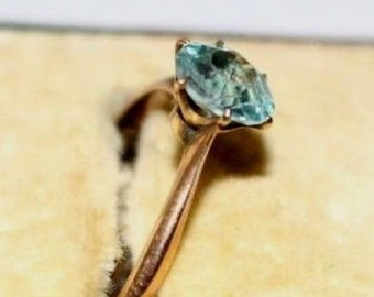 Antique rose gold and blue zircon solitaire ring
