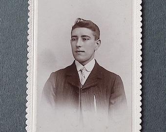 Carte-de-visite, antique.    Featuring a smart young man in a stiff collar & tie. E. Land, Moorfield Studio, Yeadon.  c1890's