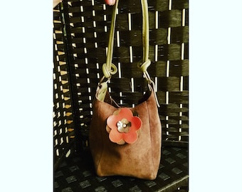 Small suede handbag with leather flower cutout