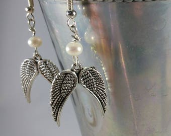 True Luster Of Genuine Pearls and Patina Wings In These Drop Earrings