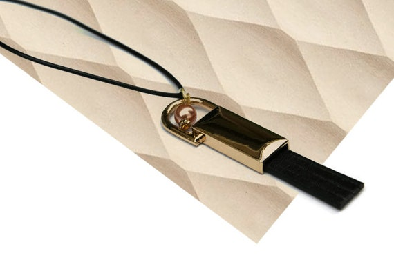 Modern recycled faux leather tassel golden color metal pendant with bead