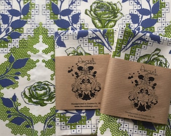 Screen-printed tea towel featuring Rose design in green and blue.
