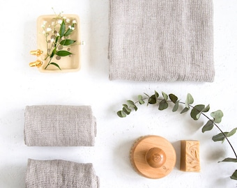 Grey bathroom towels made of natural linen will be your best bath towels