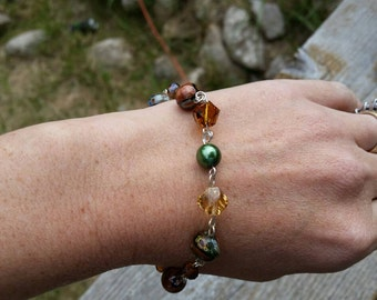 Goldstone Hand Linked Chain Beaded Bracelet with green glass pearls, and twisted crystal beads