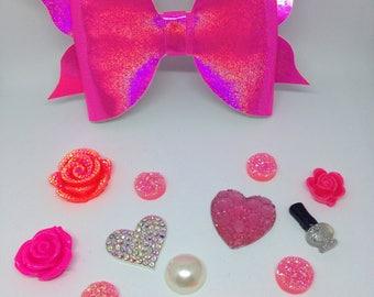 Holographic pink flutter bow