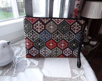 Clutch bag in tapestry style goblins with black leather strap