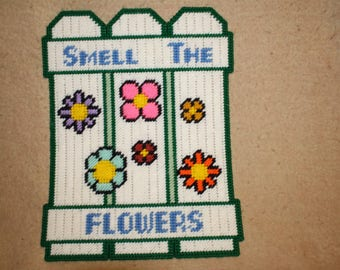 Smell the flowers fence wall hanging