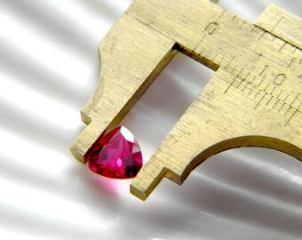 Loose gemstone lab created ruby corundum trillion undrilled