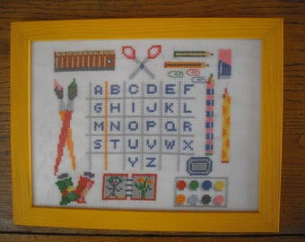 framed embroidery done by stitch, pattern painting and drawing and accessories