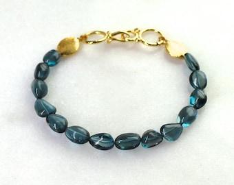 AAA London Blue Topaz Modern Bracelet in Gold Vermeil...