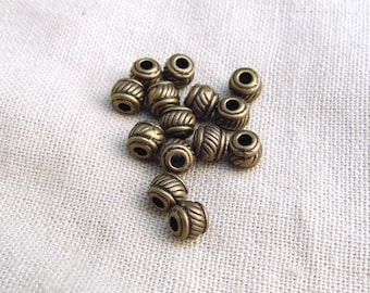 17 6 ribbed barrel beads x 5mm bronze A22032