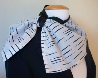 Stylish printed cotton lined with black satin, black and white convertible scarf.