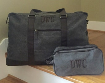 2 Piece Travel Set for Men: Monogrammed Large Gray Brushed Canvas Duffle Bag Trimmed in Dark Gray Leather-like Handles and Dopp Kit
