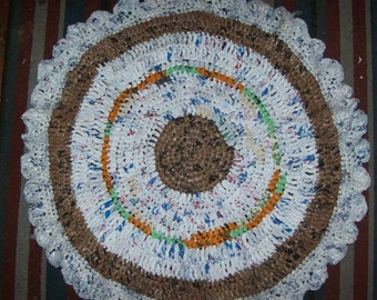 Round Floor Mat/Rug:  Made from repurposed 100% Post-consumer grocery/shopping bags!!