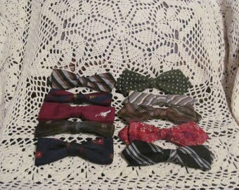 Collection of 10 bowties various materials, prints and colors.