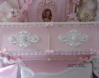 Ornament in powder pink shabby weathered shelf, full of romance...