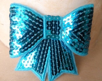 set of 2 8 x 8 cm turquoise sequin bows
