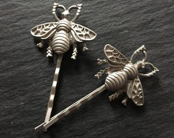 Pair of dulled silver bumble bee hair clips