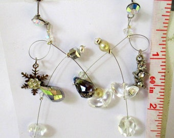 Gayla, crystals, glass,silver, stars, vintage ,unmatched, geometric, textured, metals, sculptural,   handmade, contemporary. steampunk