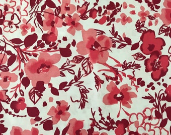 100% Cotton shades of red floral print fabric for apparel and quilting