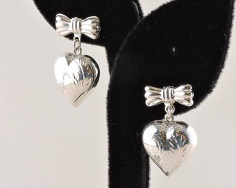 Sterling Silver Bow With Puffy Textured Heart Dangle Earrings