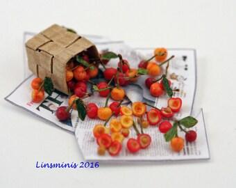 """12th scale handmade miniature """"Pitting Cherries""""."""