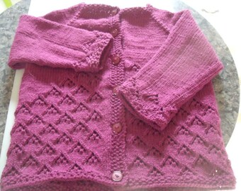 """Girl's lacy cardigan to fit up to a 24"""" chest."""