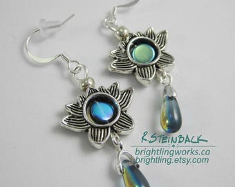 Lotus Pond Earrings; Antiqued Silver Lotus Blossoms Frame Iridescent Blue Glass and Teardrops, Accented with Bright Silver Beads & Findings