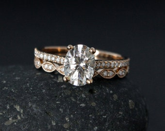 Items similar to Oval 3 Stone Moissanite Engagement Ring Forever One