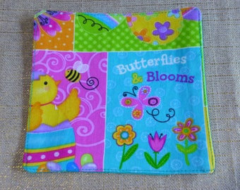 Drink Coaster. Butterflies and Blooms. Blue back.  Fully washable cotton fabric.   Fun, stylish and practical.