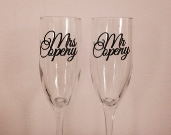 Mr and Mrs... Champagne glasses. Wedding toasting flutes