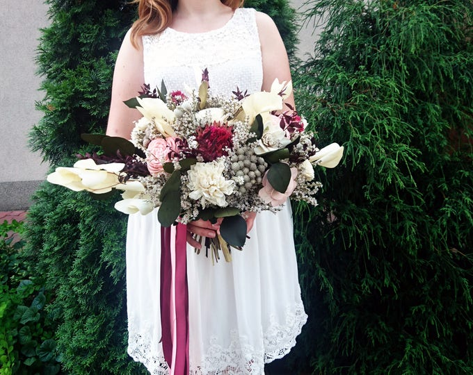 Tropical flowers bouquet in shades of wine, pink, cream and green. Perfect for boho wedding
