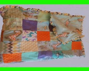 "Patchwork Crib Quilt - Light Blue Fleece with Giraffes, ""chevron"" ruffled flannel border"