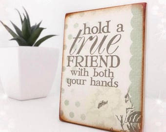 Hold A True Friend With Both Your Hands...