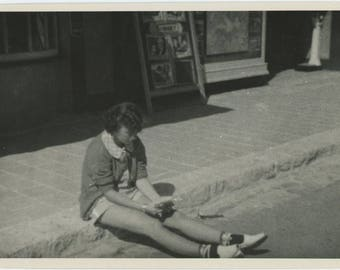 Vintage Snapshot Photo: Girl on Curb Outside Movie Theater, c1940s (75579)