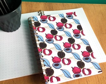 Screen printed, multicolored Litchi pattern book.