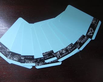 10 small blue cards decorated with masking tape black which measure 8 X 5 cm