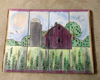 """The """"Life on the Farm"""" is a Hand-drawn Wood Burned Watercolor of the a Barn and Silo amongst the Farm Fields and Trees"""