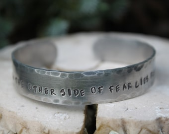 On the other side of fear lies freedom hammered cuff