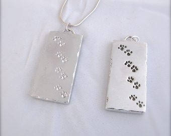 Dog Tag in Silver Representing the Paw Prints of your Dog!