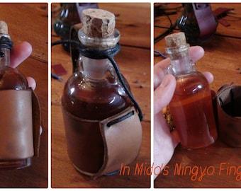 Vial of Gen Little orange leather